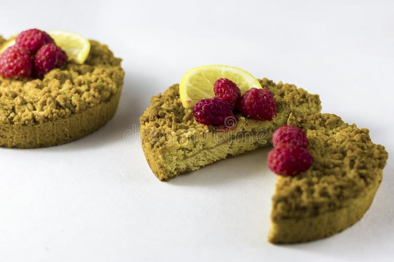 Delicious homemade crumbly shortbread cokies with raspberries. On a white background royalty free stock photography