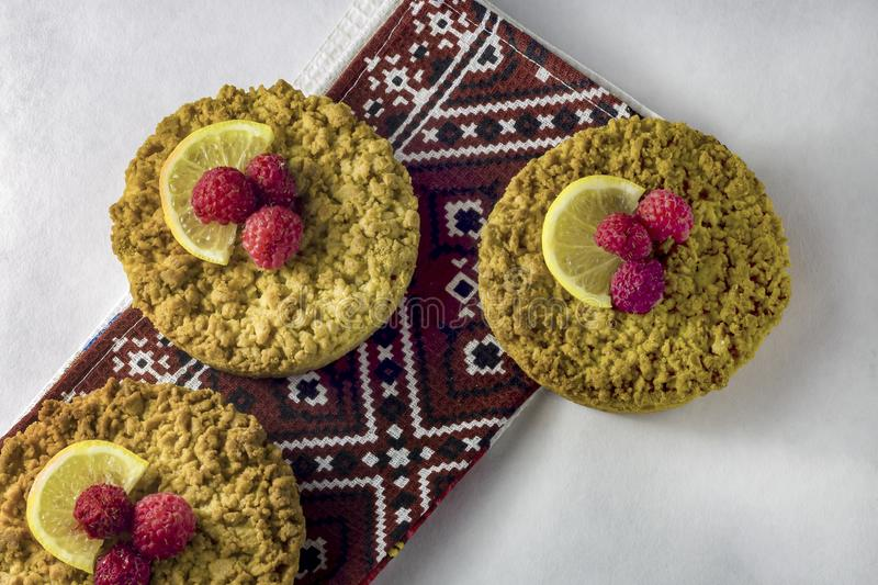 Delicious homemade crumbly shortbread cokies with raspberries. On a white background royalty free stock image