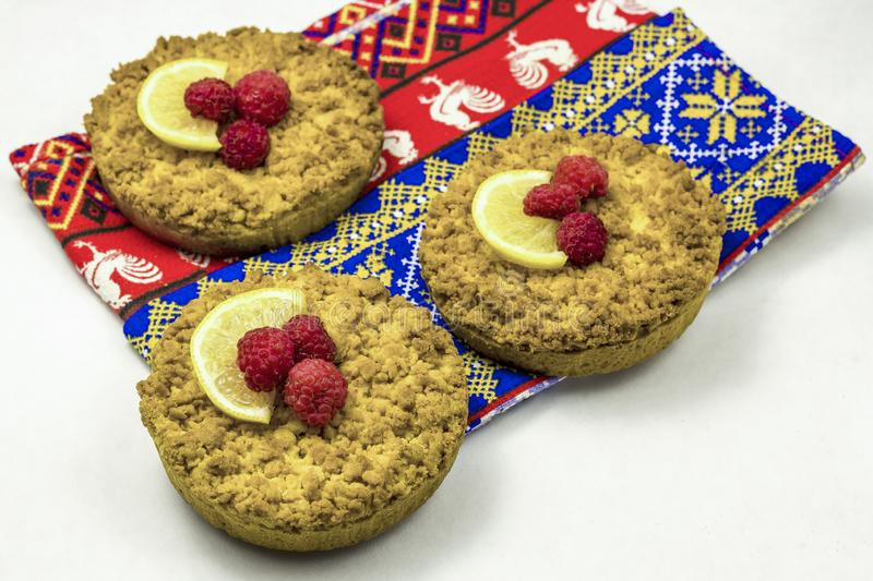 Delicious homemade crumbly shortbread cokies with raspberries. On a white background royalty free stock photo