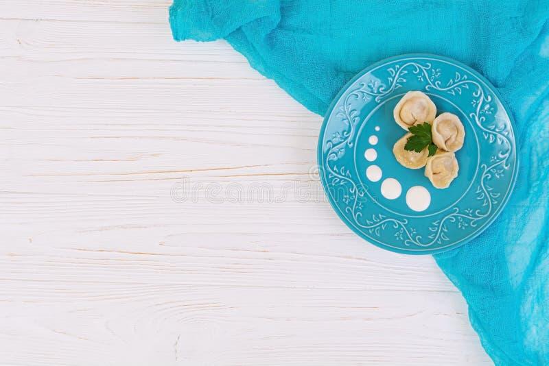 Delicious homemade dumplings, pelmeni, on wooden background royalty free stock photo