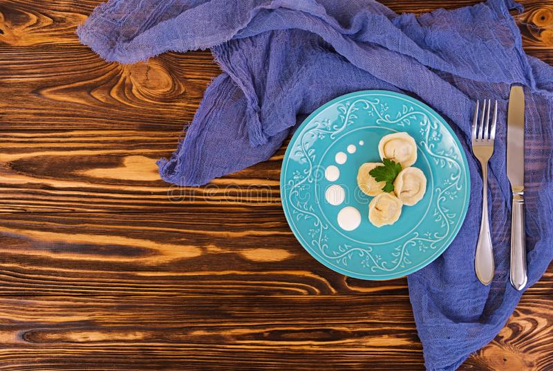 Delicious homemade dumplings, pelmeni, on wooden background stock image