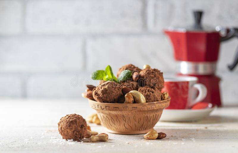 Delicious homemade energy balls with dried apricots, dates, prunes, walnuts, almonds and cashews in coconut and cocoa. Vegan and. Vegetarian raw snack or meal royalty free stock photos