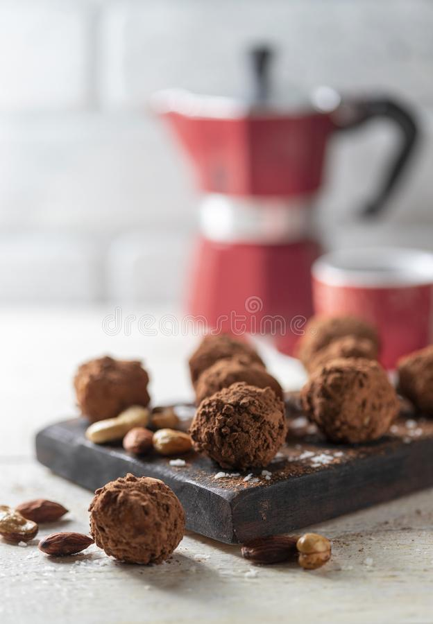 Delicious homemade energy balls with dried apricots, dates, prunes, walnuts, almonds and cashews in coconut and cocoa. Vegan and. Vegetarian raw snack or meal royalty free stock photo