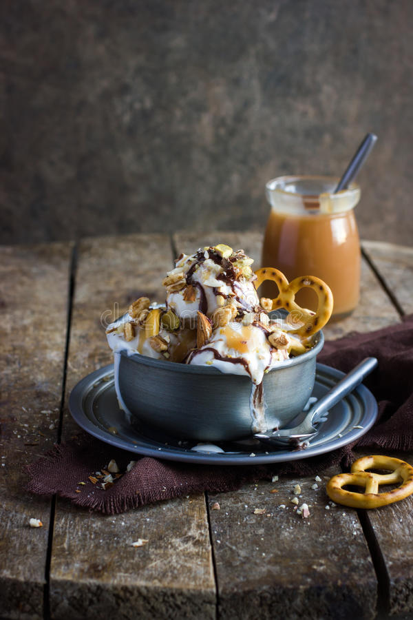 Delicious homemade ice cream with salted caramel and chocolate royalty free stock photo