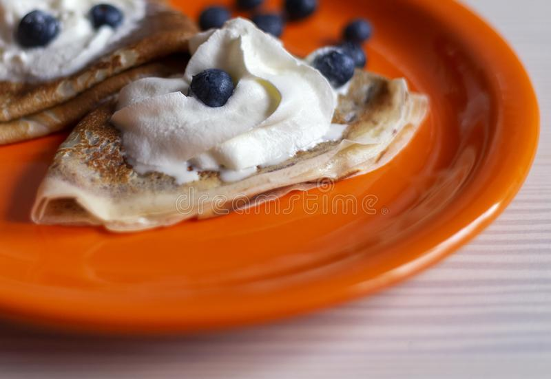 Delicious homemade pancakes and fruits on the plate with blurry background royalty free stock photos
