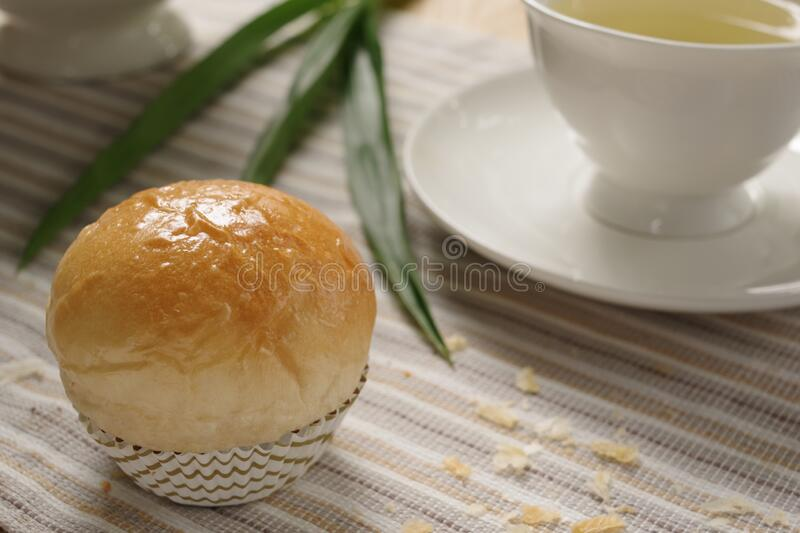 A delicious homemade pandan custard bread with earl grey in the afternoon tea time. royalty free stock photos