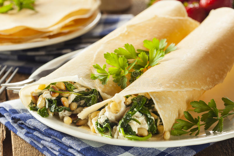 Delicious Homemade Spinach and Feta Savory French Crepes. Delicious Homemade Savory French Crepes with Spinach and Feta royalty free stock photo
