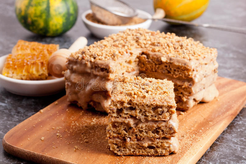 Delicious honey cake on a desk close-up. Horizontal royalty free stock photos