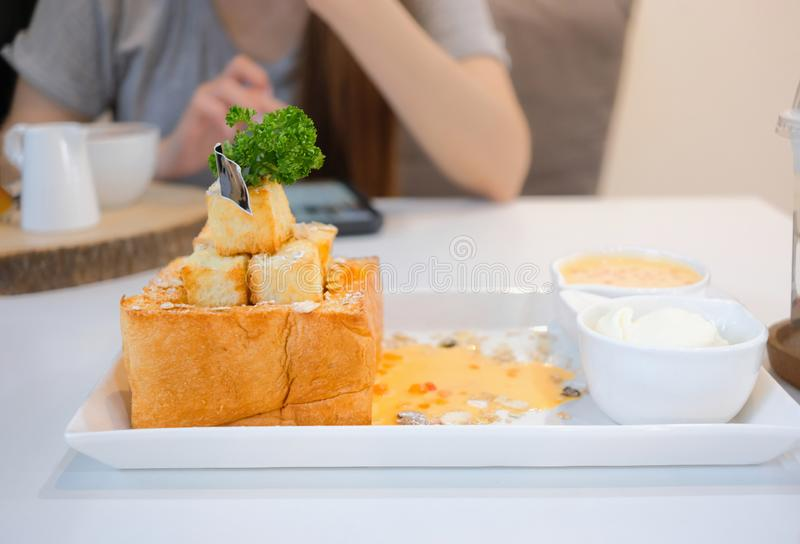 Delicious honey toast with topping and sauce. Dessert meal of gourmet royalty free stock photo