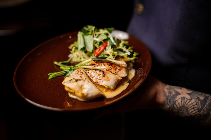 Delicious and hot chicken fillet with fresh vegetable salad stock photos