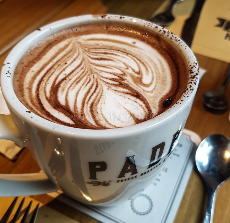 Delicious hot chocolate in bakery royalty free stock images