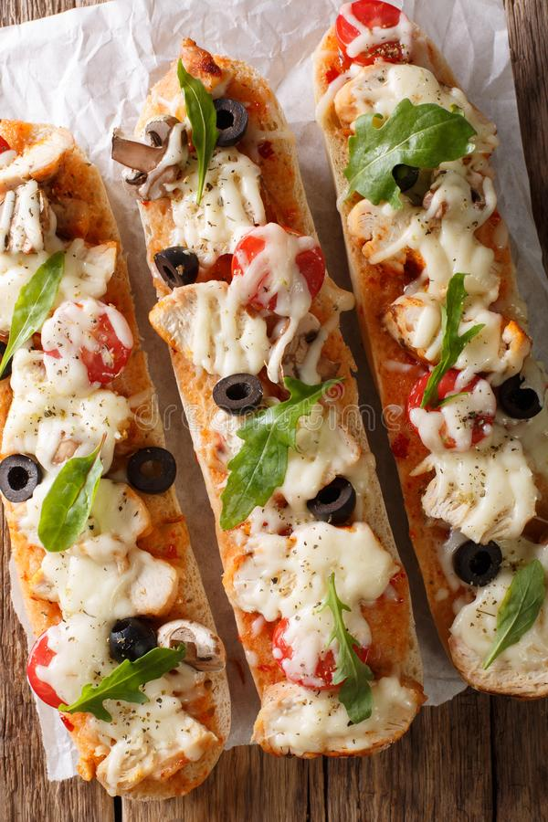 Delicious hot sandwich casserole pizza with chicken, cheese, tom royalty free stock image