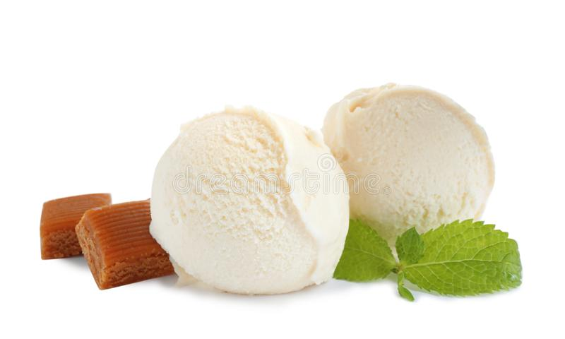 Delicious ice cream with caramel candies and mint. On white background stock image