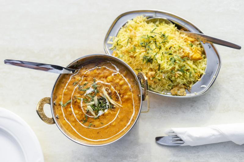 Delicious Indian food - tarka dal and egg rice royalty free stock photos