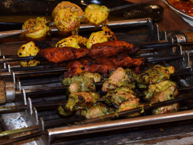 Delicious Indian Kebabs  food grilled over burning charcoal fire stock image