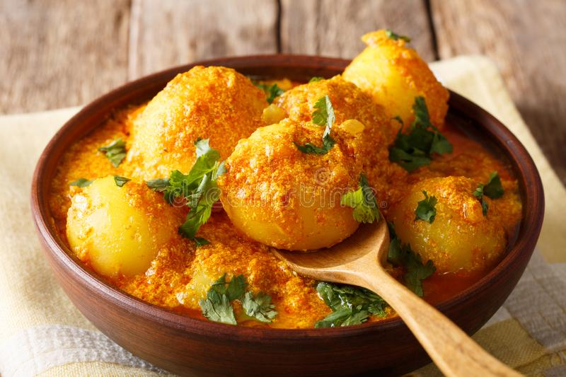 Delicious Indian Potato Dum aloo in curry sauce close-up. horizontal royalty free stock photo