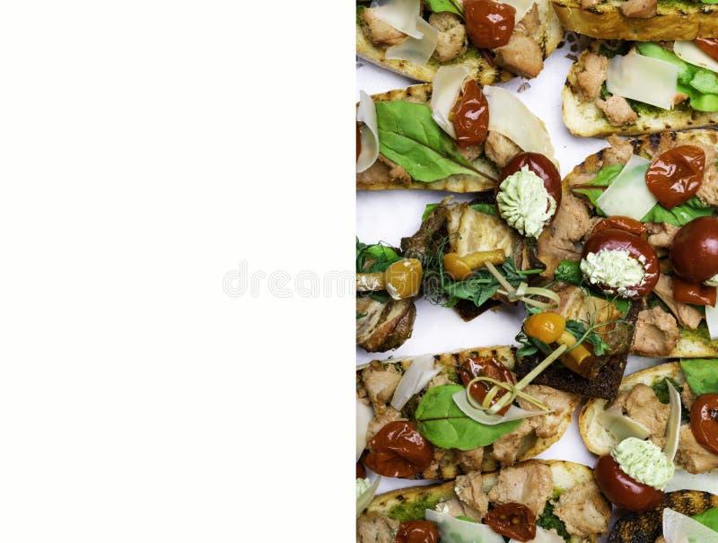 Delicious Italian antipasti bruschetta with tomato, meat pate, olives and tuna cream, mozzarella . Set of tasty appetizer. Sandwiches. close up stock images