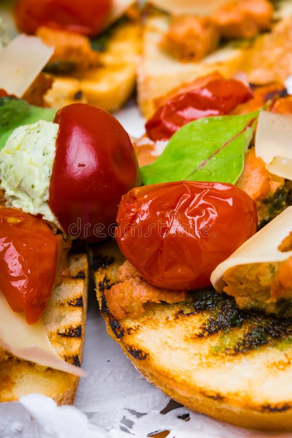 Delicious Italian antipasti bruschetta with tomato, meat pate, olives and tuna cream, mozzarella . Set of tasty appetizer. Sandwiches. close up royalty free stock photography