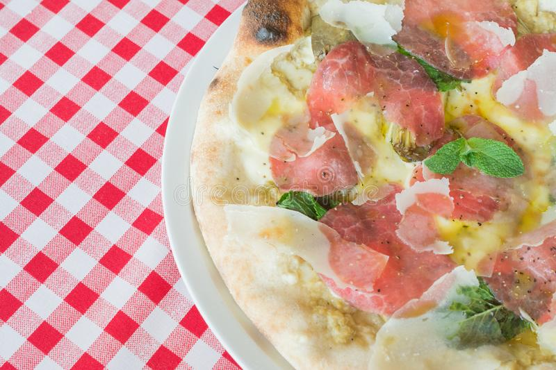 Delicious Italian beef pizza. For an exclusive recipe stock images