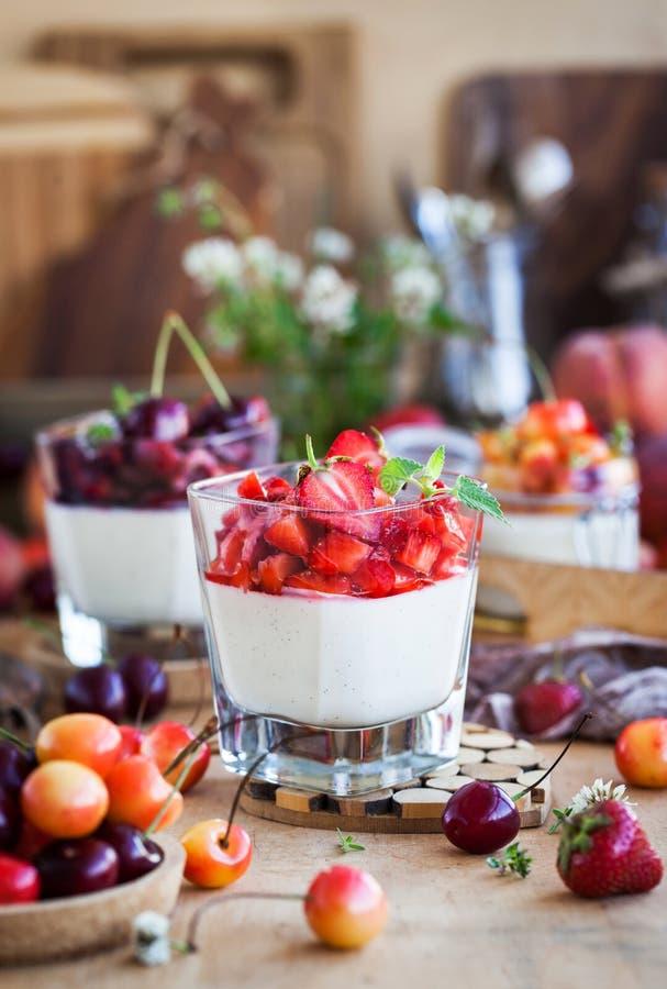 Delicious Italian dessert Panna Cotta with fresh summer berries royalty free stock photos