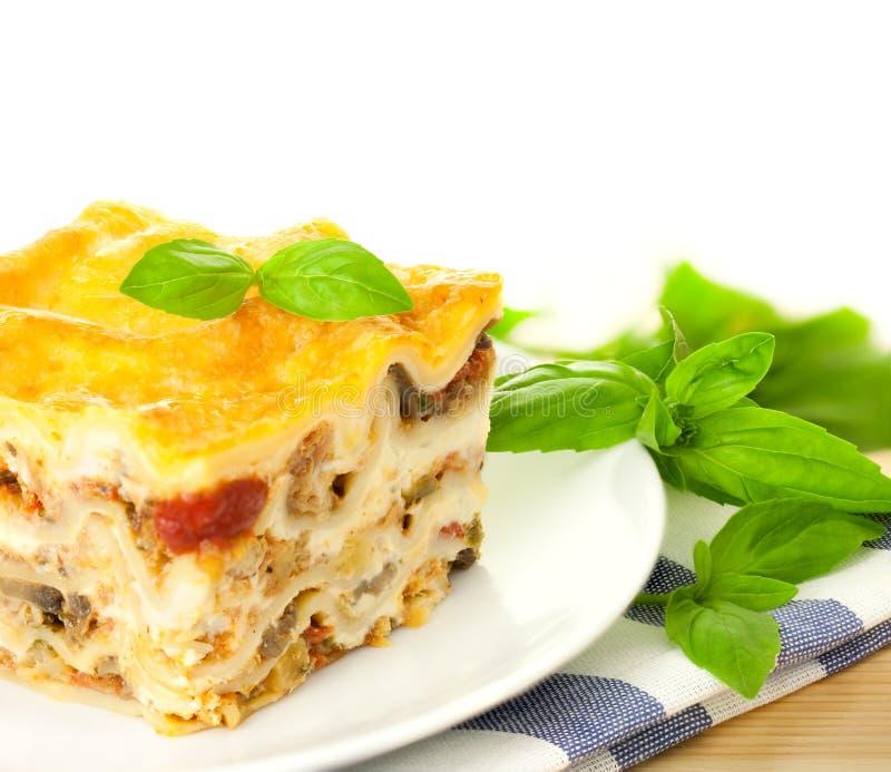 Delicious Italian Lasagna / With Fresh Basil Royalty Free Stock Photo