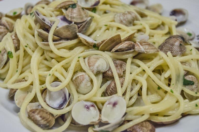 Delicious Italian pasta with seashells. Spaghetti. Italian pasta with seashells. Specialty in the city of Comacchio, near Venezia stock image