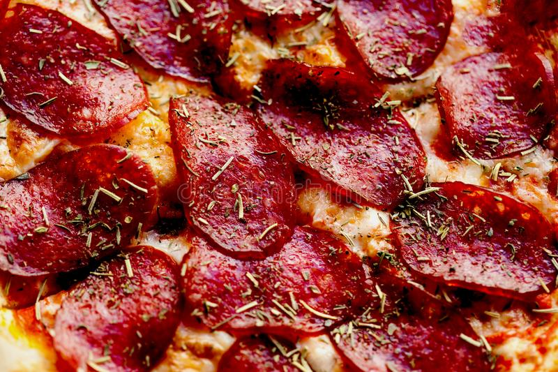 Delicious italian pepperoni pizza texture close up stock image