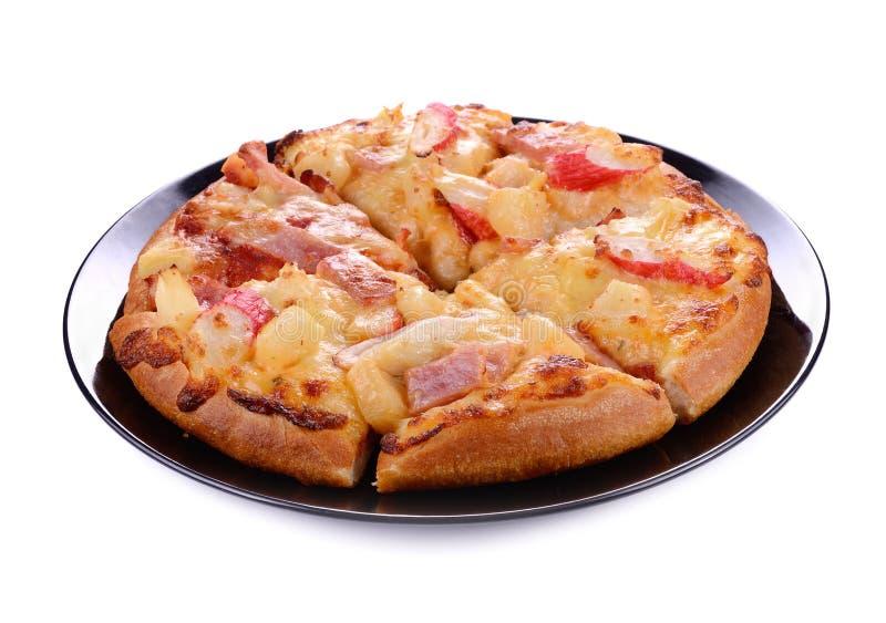 Delicious italian pizza on black plate.  royalty free stock photos