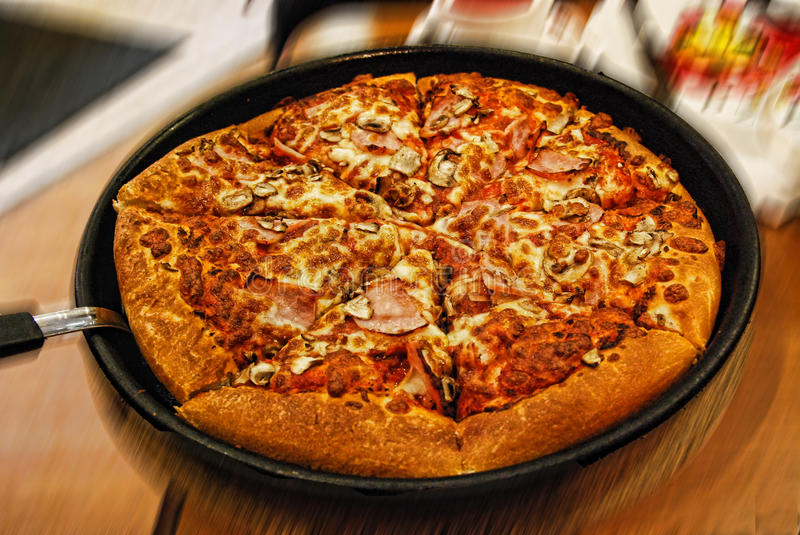 Delicious Italian Pizza in a pan at Restaurant stock photo
