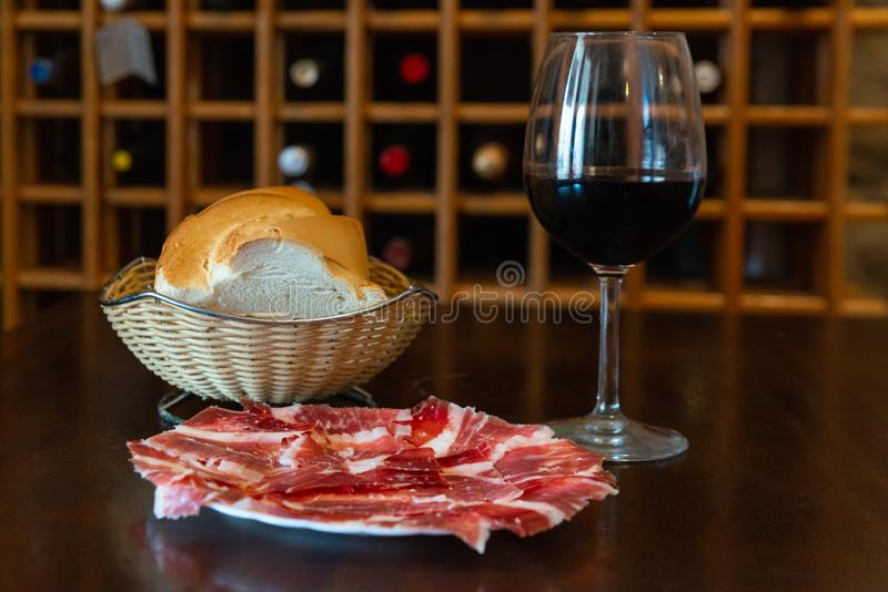 Delicious jamon  with wine and bread. Delicious jamon with wine and bread stock image