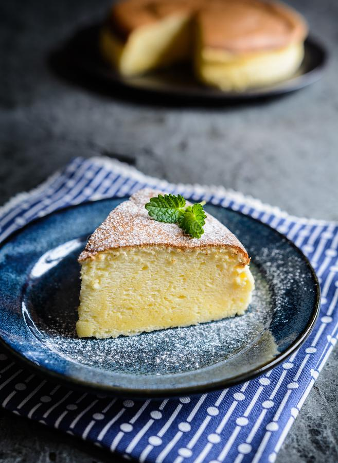 Delicious Japanese cheesecake with powdered sugar icing royalty free stock photography