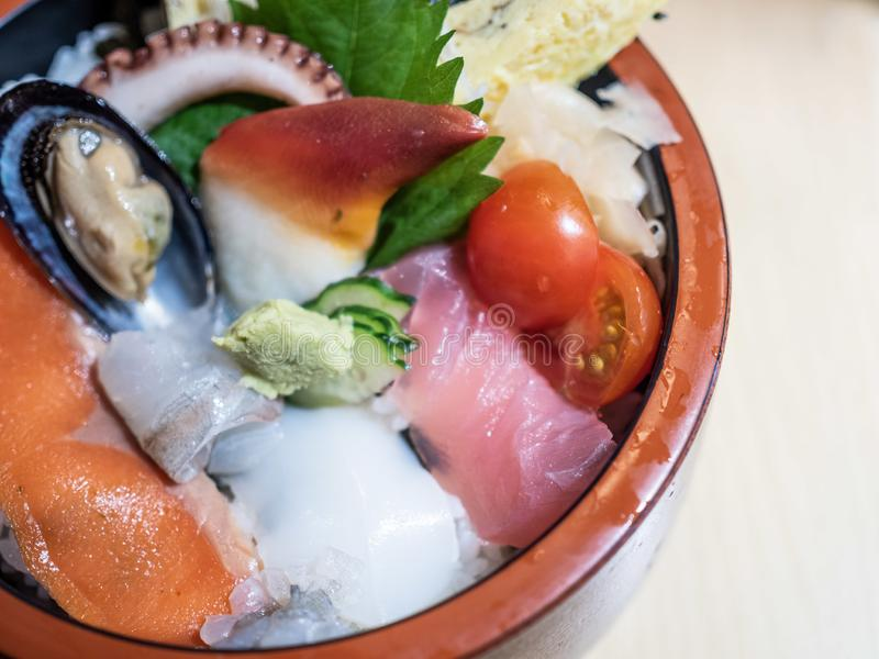 Delicious Japanese Sashimi Don. Beautiful Japanese rice bowl with variety of fresh seafood and a chunk of wasabi called Sashimi don royalty free stock images