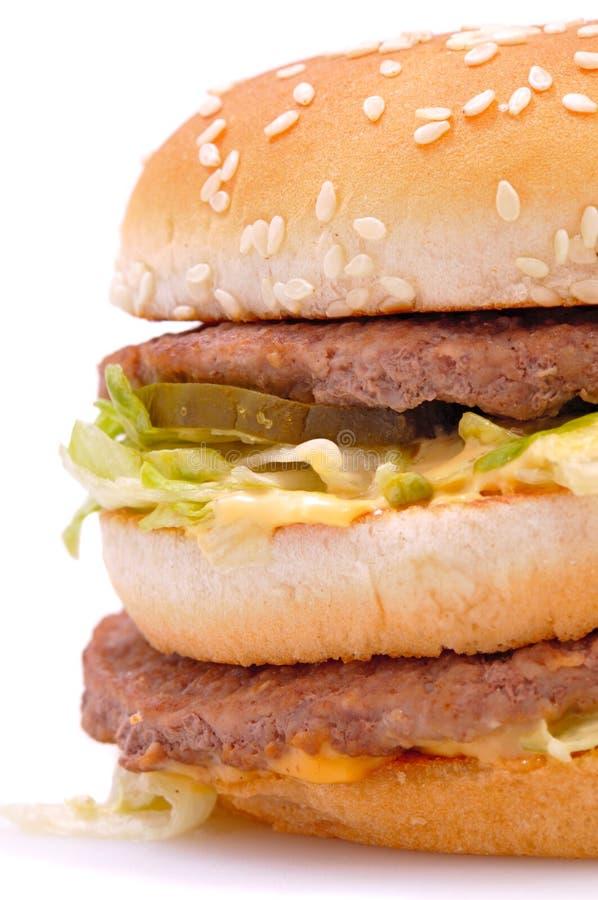 Delicious juicy cheeseburger/hamburger royalty free stock image