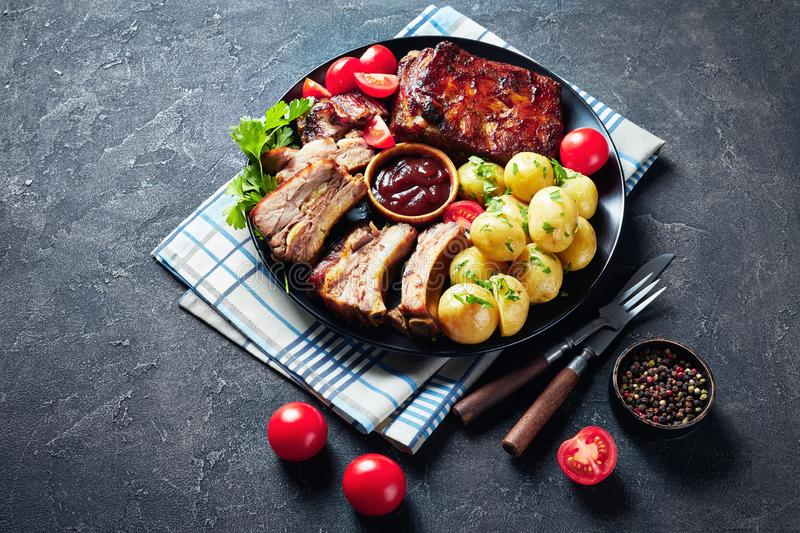 Delicious juicy grilled pork ribs and veggies royalty free stock photography
