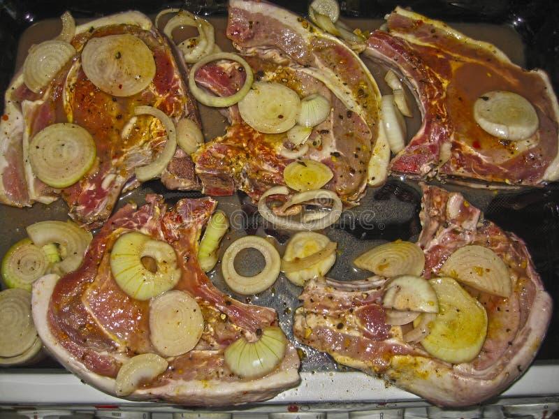 Delicious lamb ribs lie marinated and ready to bake royalty free stock photos