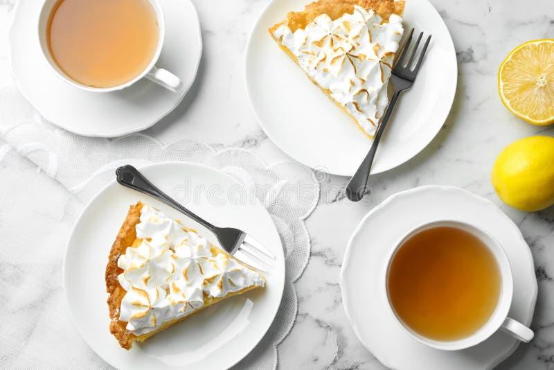 Delicious lemon meringue pie on white marble table, flat lay. Delicious lemon meringue pie served on white marble table, flat lay royalty free stock image