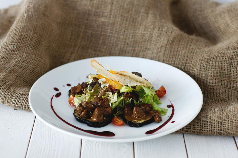 Delicious liver with eggplant royalty free stock photo