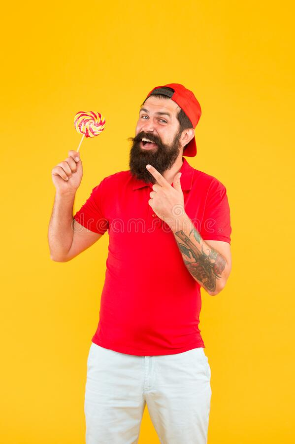 Delicious lollipop. Nutritional values. Calories and vitamin. Homemade caramel candy. Sweets addicted. Hipster lollipop stock photo
