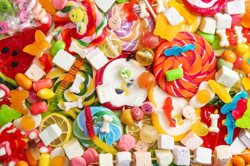 Delicious lollipops and sweets as background stock images