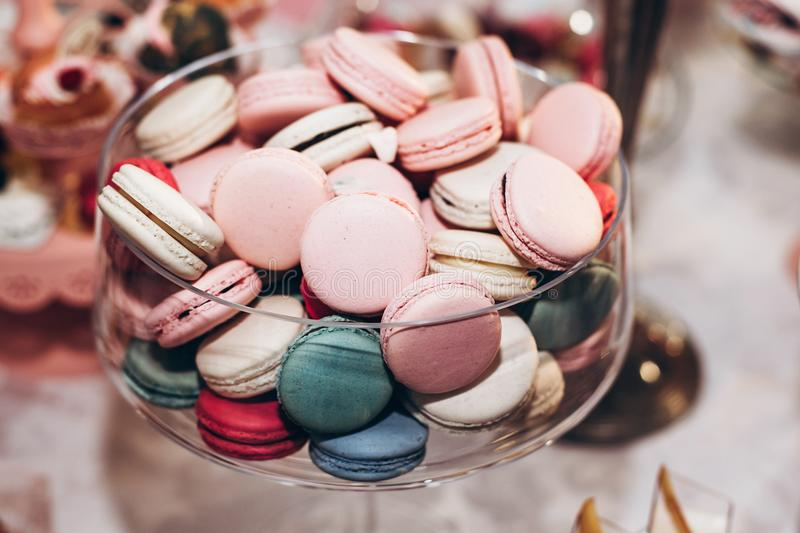 delicious macaroons close-up. candy bar at luxury wedding reception. exclusive expensive catering. table with modern desserts. sp stock image