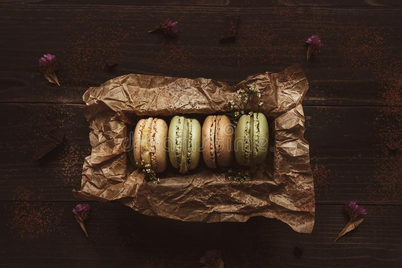 Delicious macaroons in gift box on the wooden table, top view stock photo
