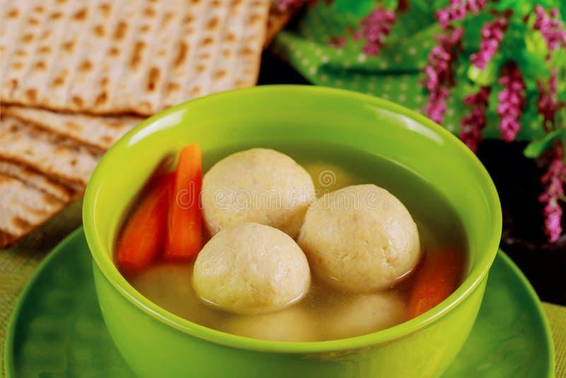 Delicious matzo ball soup with carrot and matzos bread. Close up. Delicious matzo ball soup with carrot and matzos bread. Jewish holiday concept. Close up stock photos