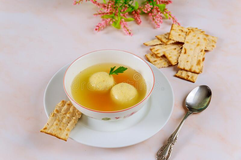 Delicious matzo ball soup with carrot and matzos bread. Jewish holiday concept royalty free stock photo
