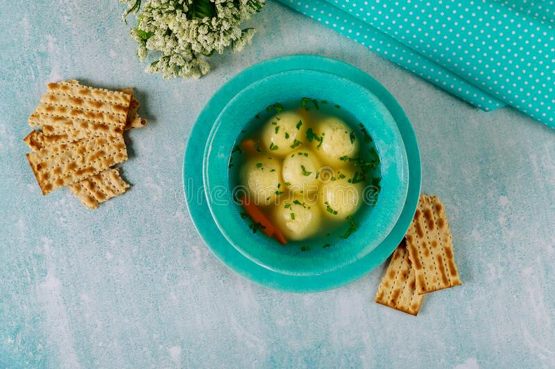 Delicious matzo ball soup with carrot and matzos bread. Jewish holiday concept stock photography