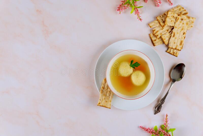 Delicious matzo ball soup with carrot and matzos bread. Top view. Jewish holiday concept stock photos