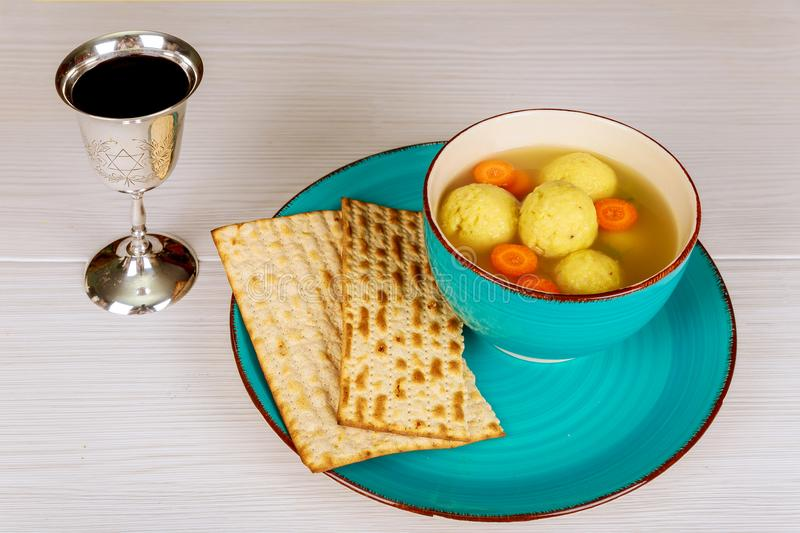 Delicious Matzoh ball soup with Pesach Passover symbols. Delicious Matzoh ball soup with matzah, Jewish symbols for the Passover Pesach holiday royalty free stock image