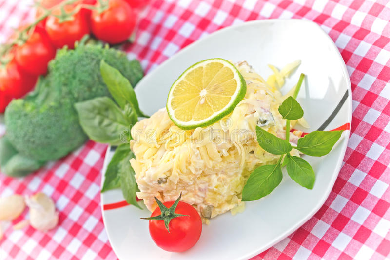 Delicious meal - cold salad (Mimosa salad). On table royalty free stock photography