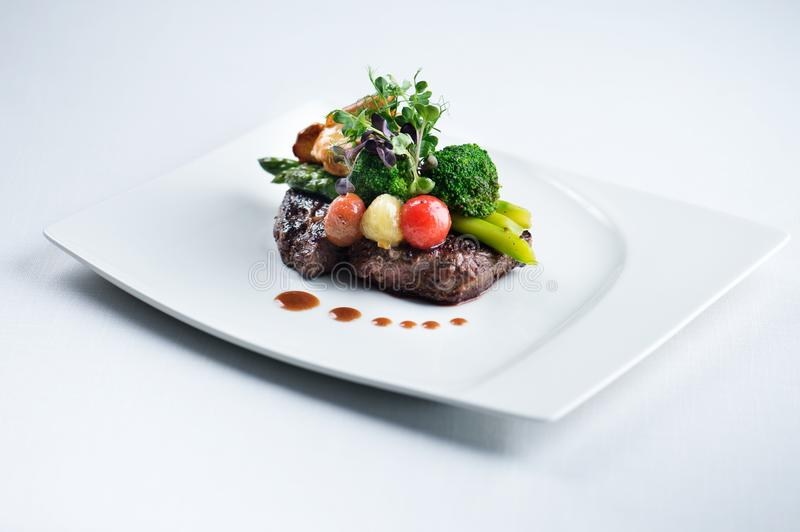 A delicious meal - Ribeye Steak Black Angus with asparagus. A delicious meal! Have you tasted Ribeye Steak Black Angus with asparagus from the menu stock photo