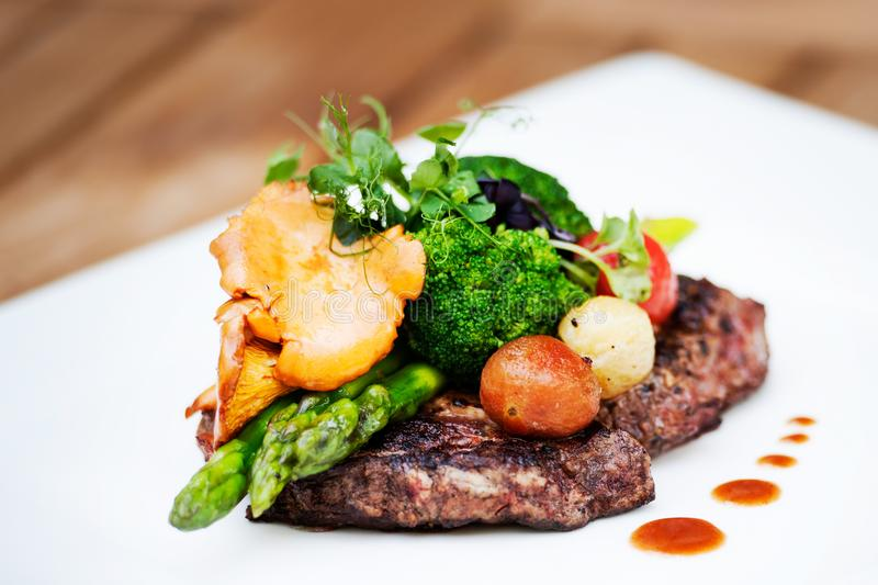 A delicious meal - Ribeye Steak Black Angus with asparagus. A delicious meal! Have you tasted Ribeye Steak Black Angus with asparagus from the menu royalty free stock images