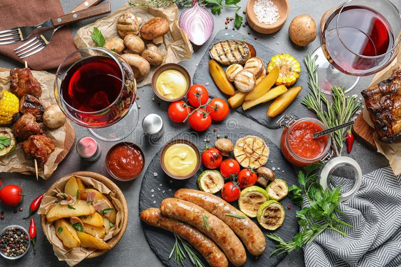 Delicious meal served for barbecue party on gray table royalty free stock photography